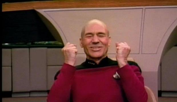 Captian Picard from Star Trek cheering